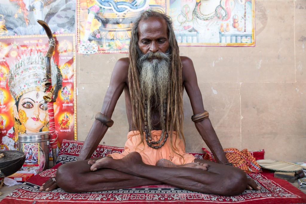 Sadhu sits on the ghat in Varanasi. October 4, 2016. ©robertmoses