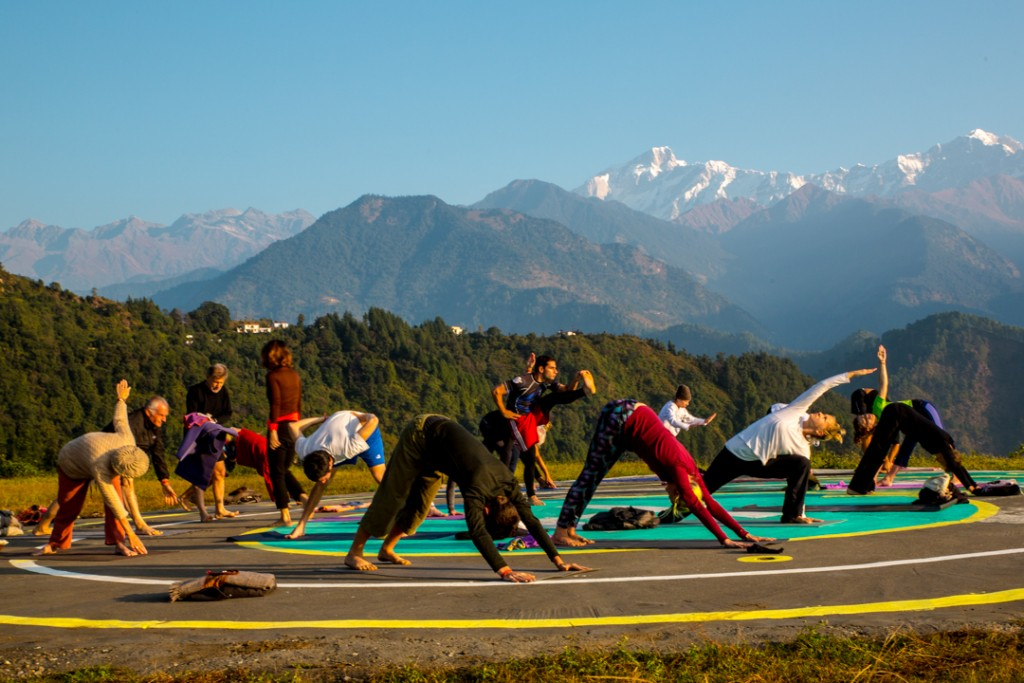 Yoga on the helipad at Char Dham Guptakashi. October 2015 ©robertmoses