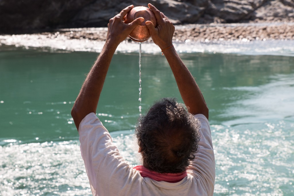 Offering scared water into the sacred waters of the Bhagirathi (white) and Alaknanada (green) Rivers at Devprayag. From there the waters become known as Ganga. October 2015. ©robertmoses