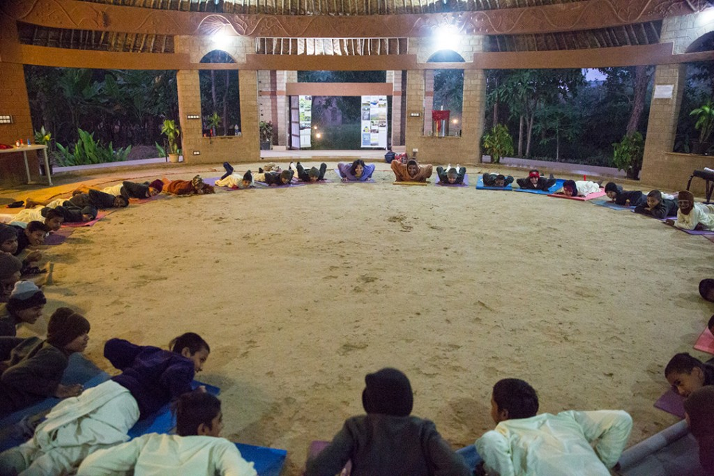 Children from the Gurukula doing yoga in the Yoga Shala during brahmamuhurta. December 2015. ©robertmoses