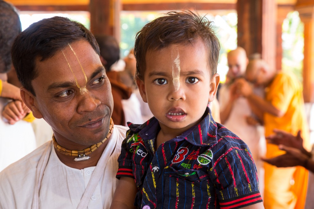Father and son at morning darshan.  Govardhan Ecovillage. December 2015 ©robertmoses