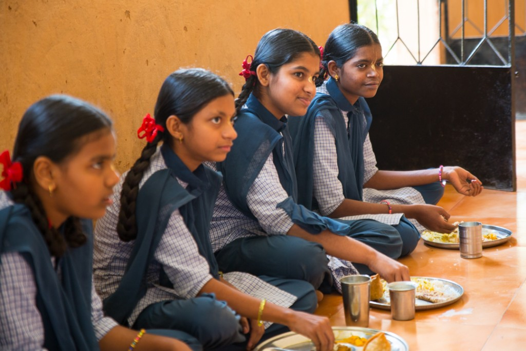 Girls in the gurukul at prasad time. Girl second from right can recite the complete Bhagavad Gita by heart. December 2015. ©robertmoses