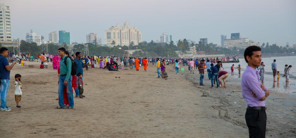 The swamis almost vanish into the laypeople crowding Chowpatty beach at evening. ©robert moses