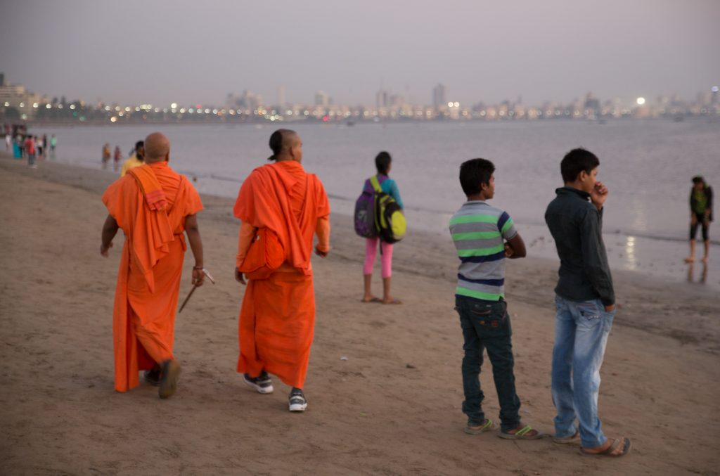 The swamijis stroll back and forth along the crowded Chowpatty Beach. ©robert moses