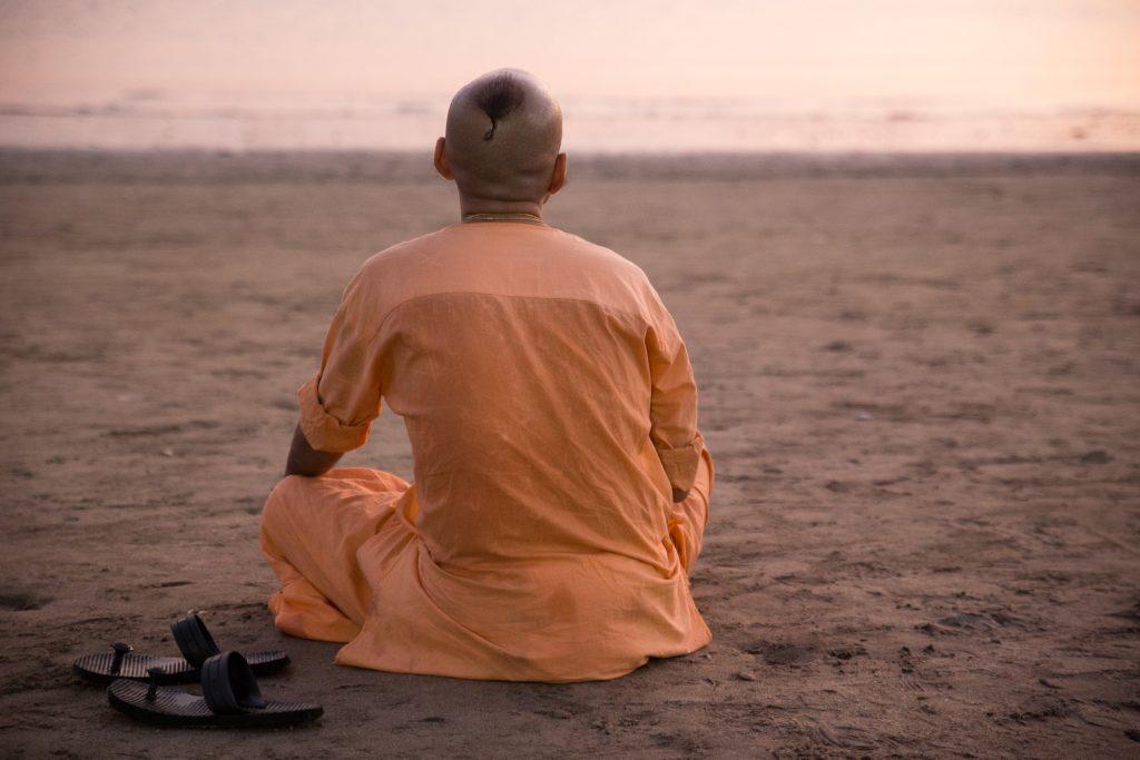 Prem Gauranga das sits for evening Gayatri as the sun sets. ©robertmoses