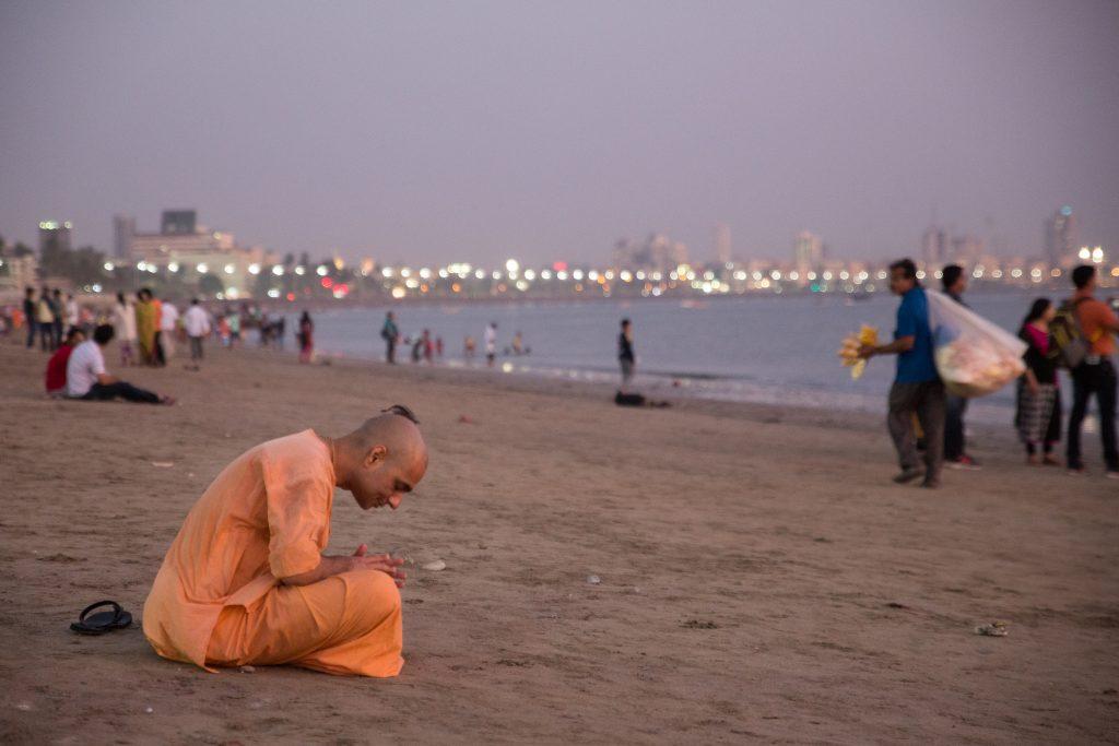 Prem Gauranga das salutes the setting sun over Chowpatty Beach. ©robertmoses