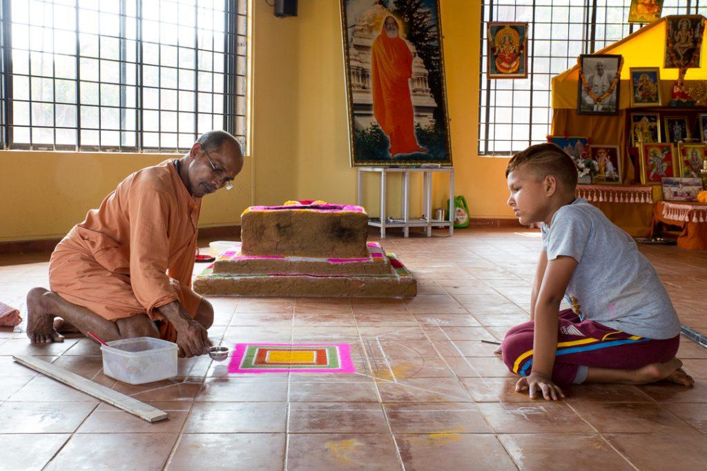 Swami Nivedanananda preps for Homa. ©robertmoses