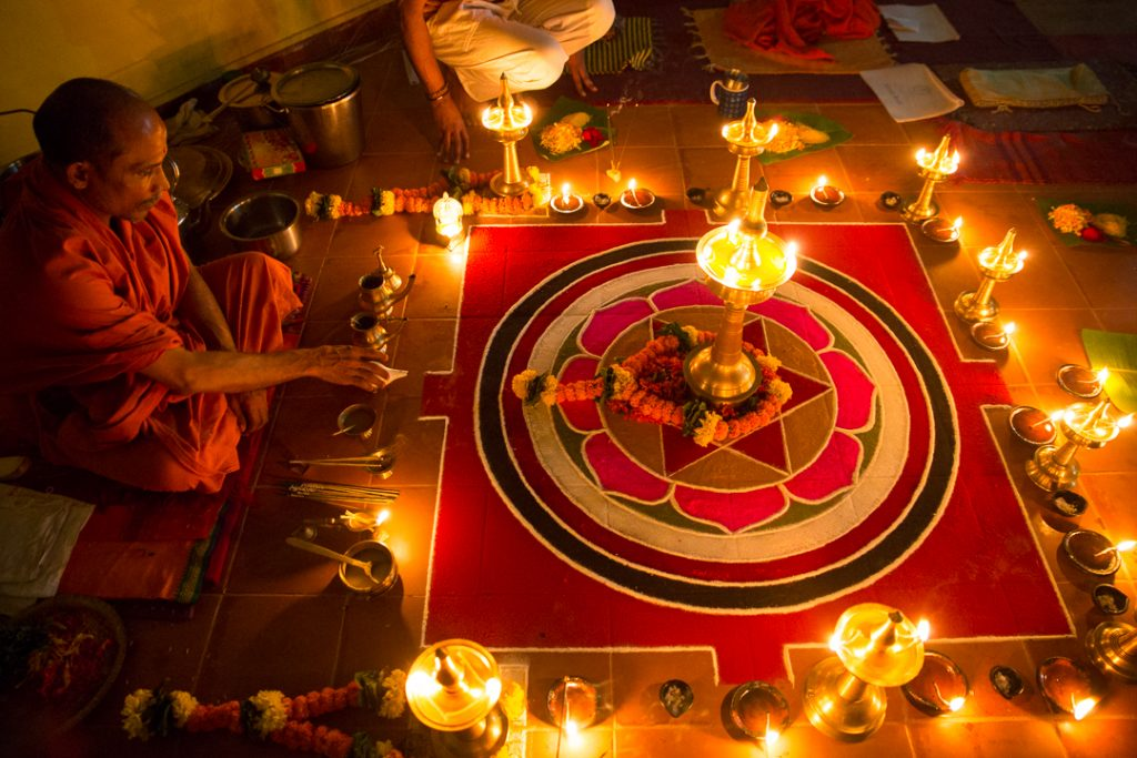 Durga Mata being invoked in the lamp during Her puja by Swami Nivedanananda. ©robert moses