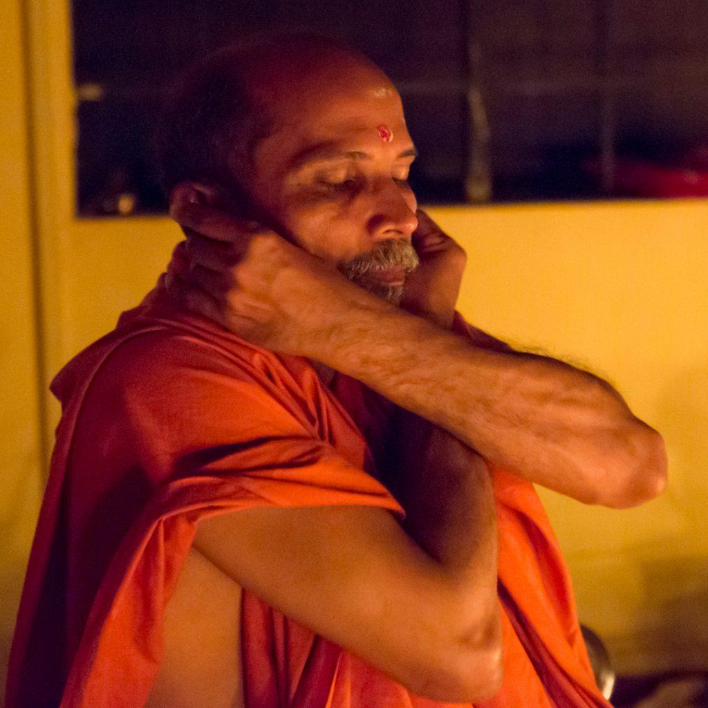 Swami Nivedananadaji prepares for homa. ©robert moses