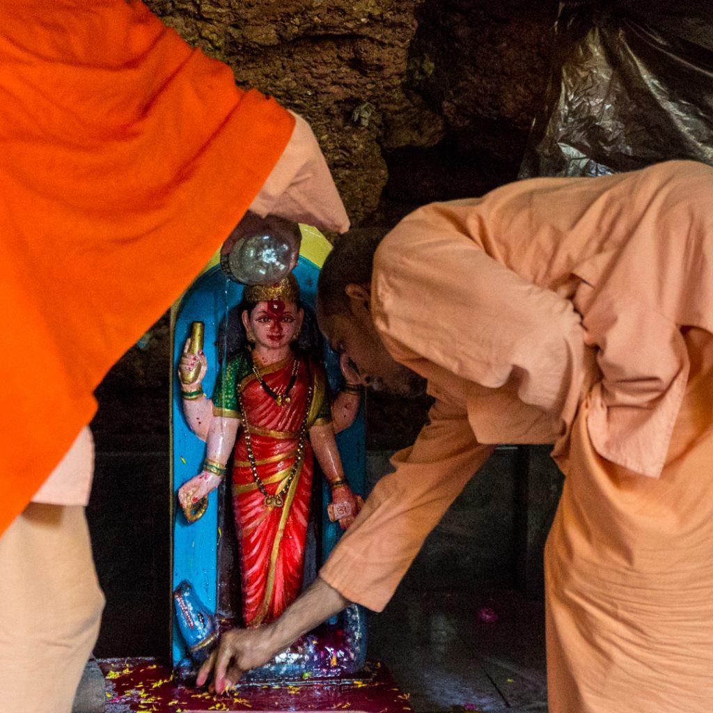 Swami Govindananda and Swami Nivedananda worship Ganga Ma. ©robertmoses